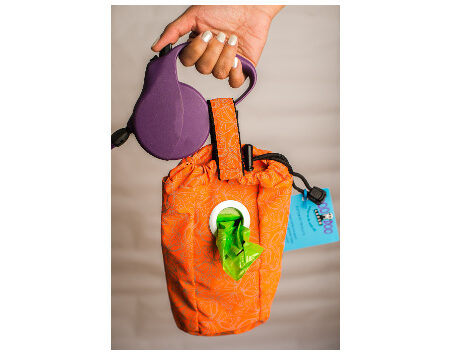 Poo doo pouch that holds dog bags, pet waste and personal items separately!